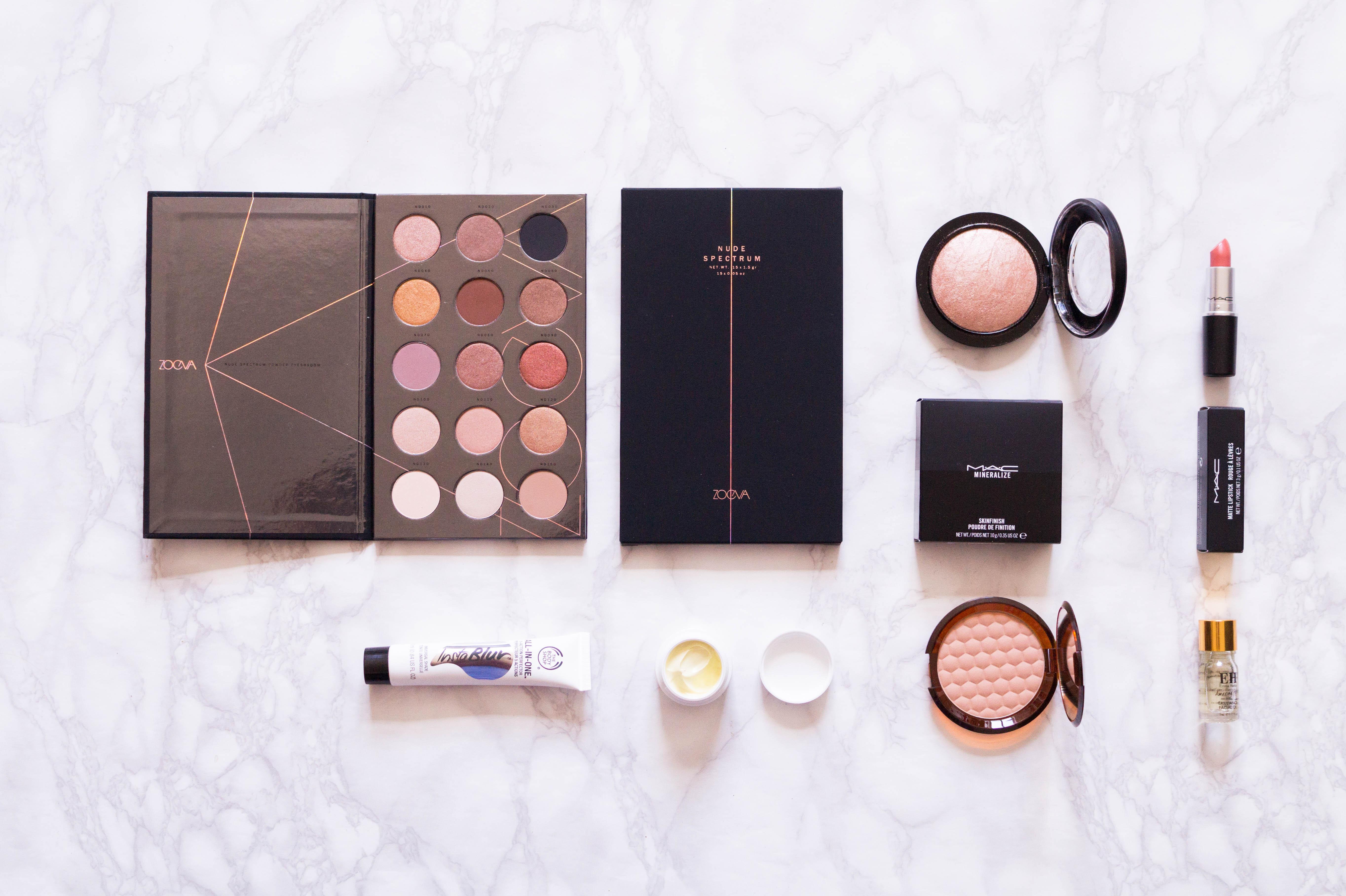 makeup haul flatlay zoeva mac lipstick soft and gentle highlighter the body shop bronzer
