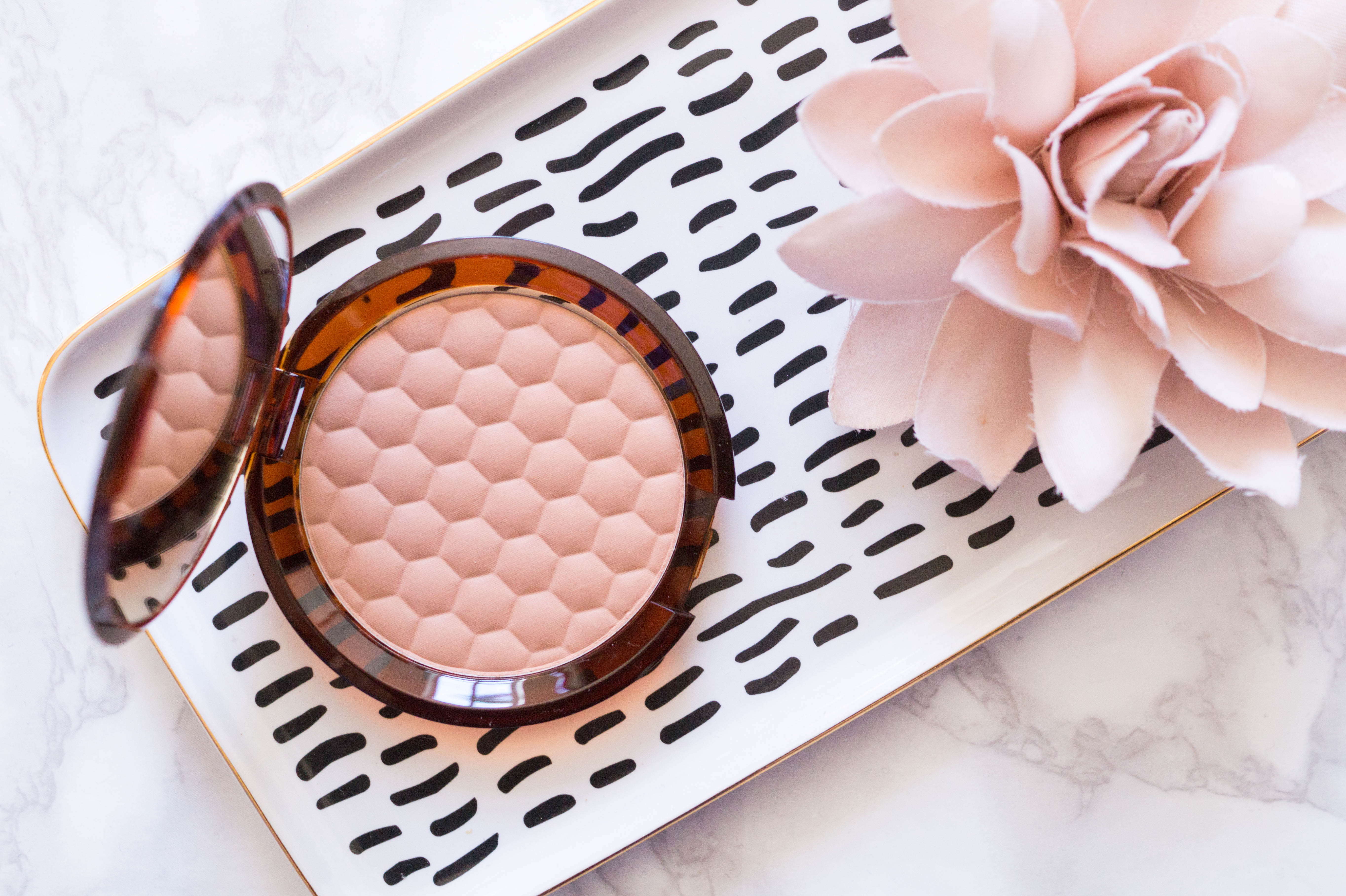 high end beauty haul flatlay the body shop honey bronzer
