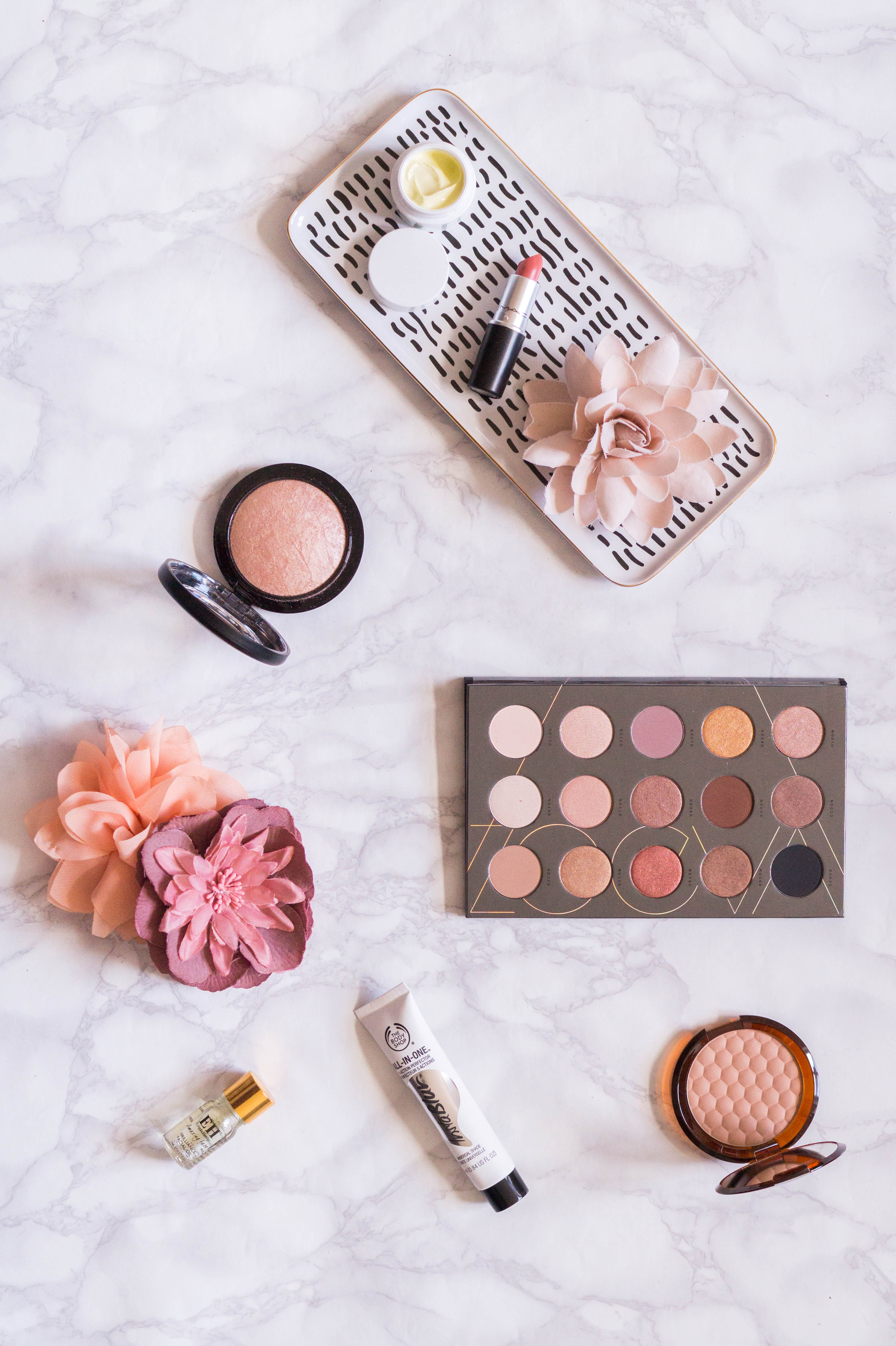 high end beauty haul flatlay zoeva mac lipstick soft and gentle highlighter the body shop bronzer