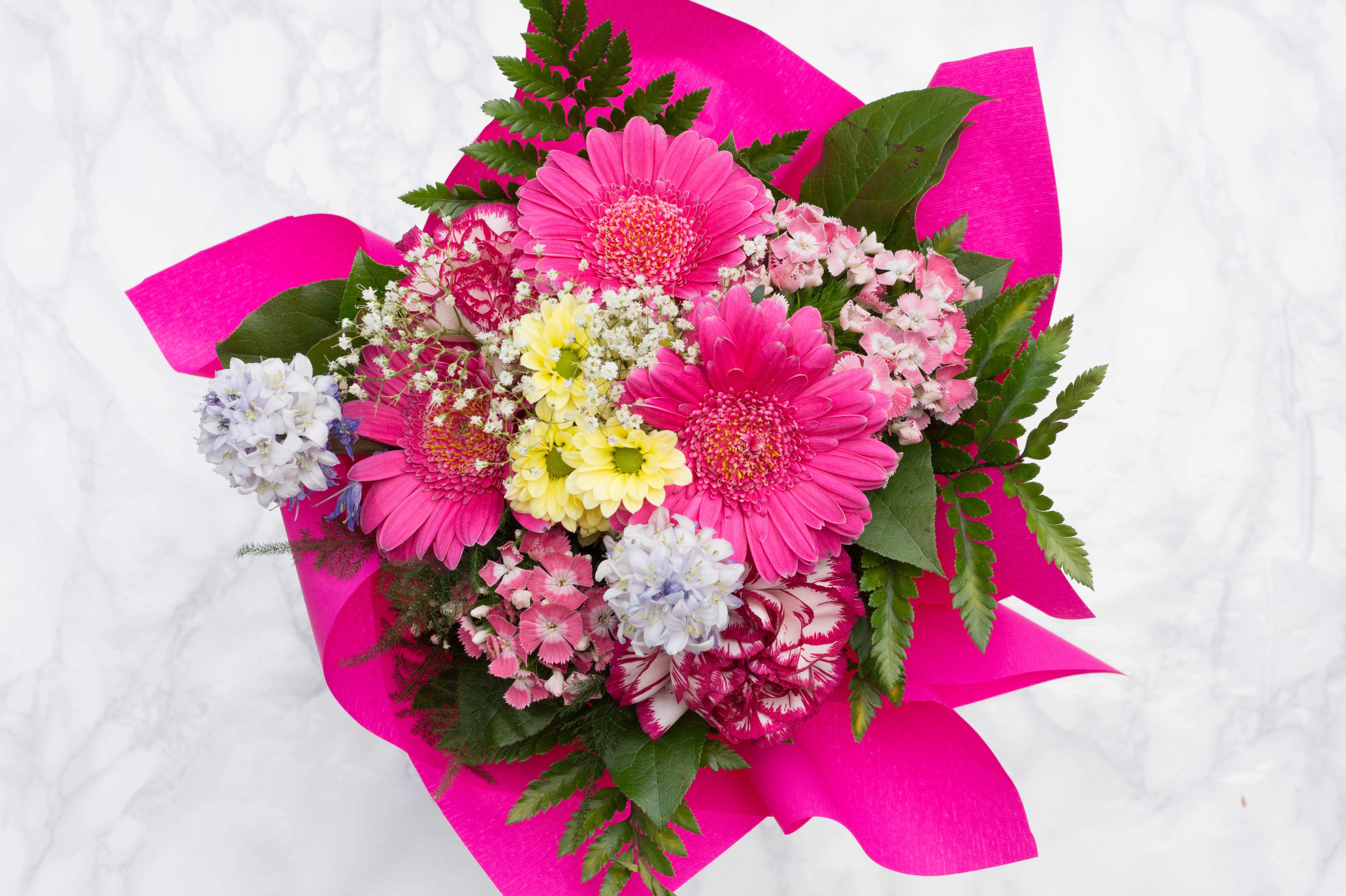 monthly favorites primetime chaos flatlay flowers bouquet