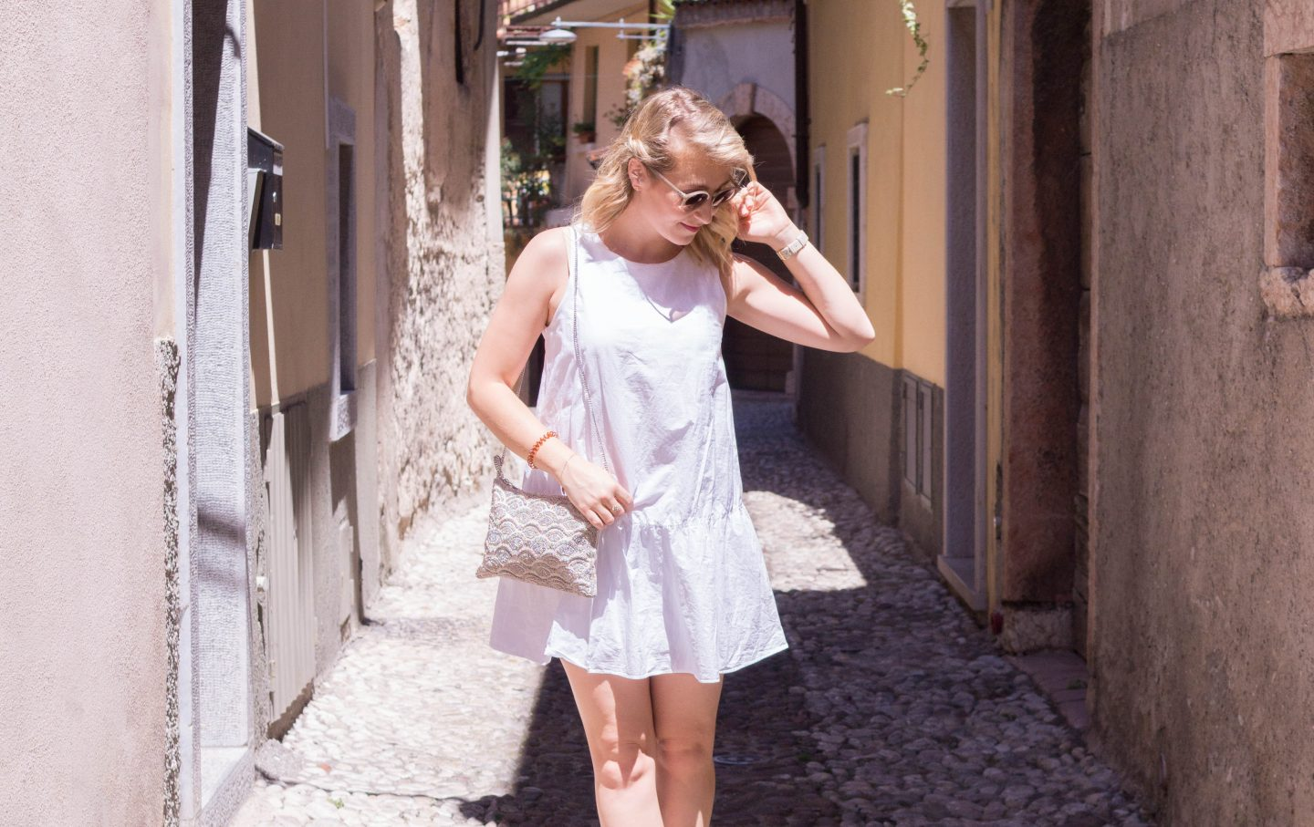 White Ruffle Dress & Sparkly Bag in Malcesine, Italy