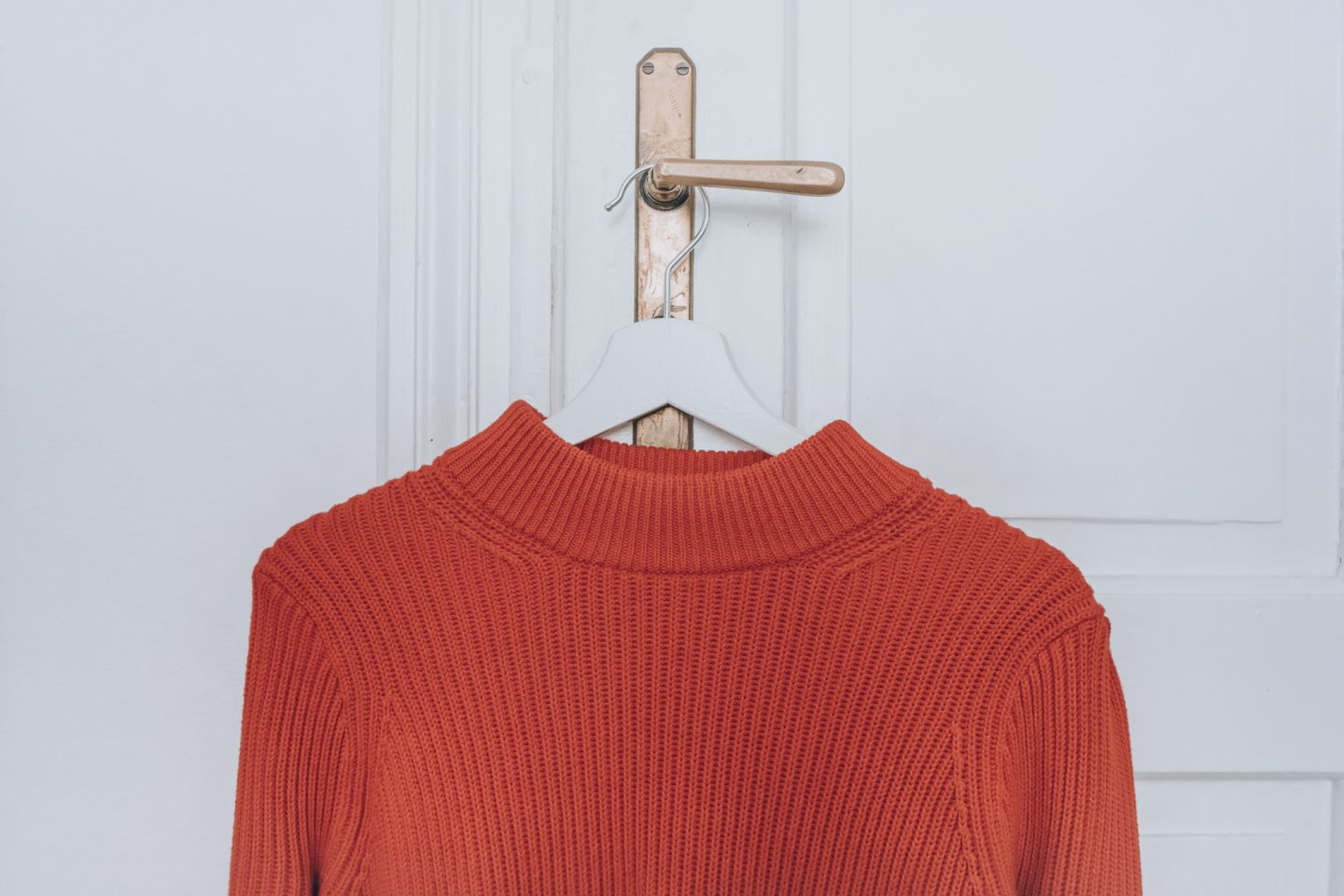 Red Knitted Sweater on a hanger